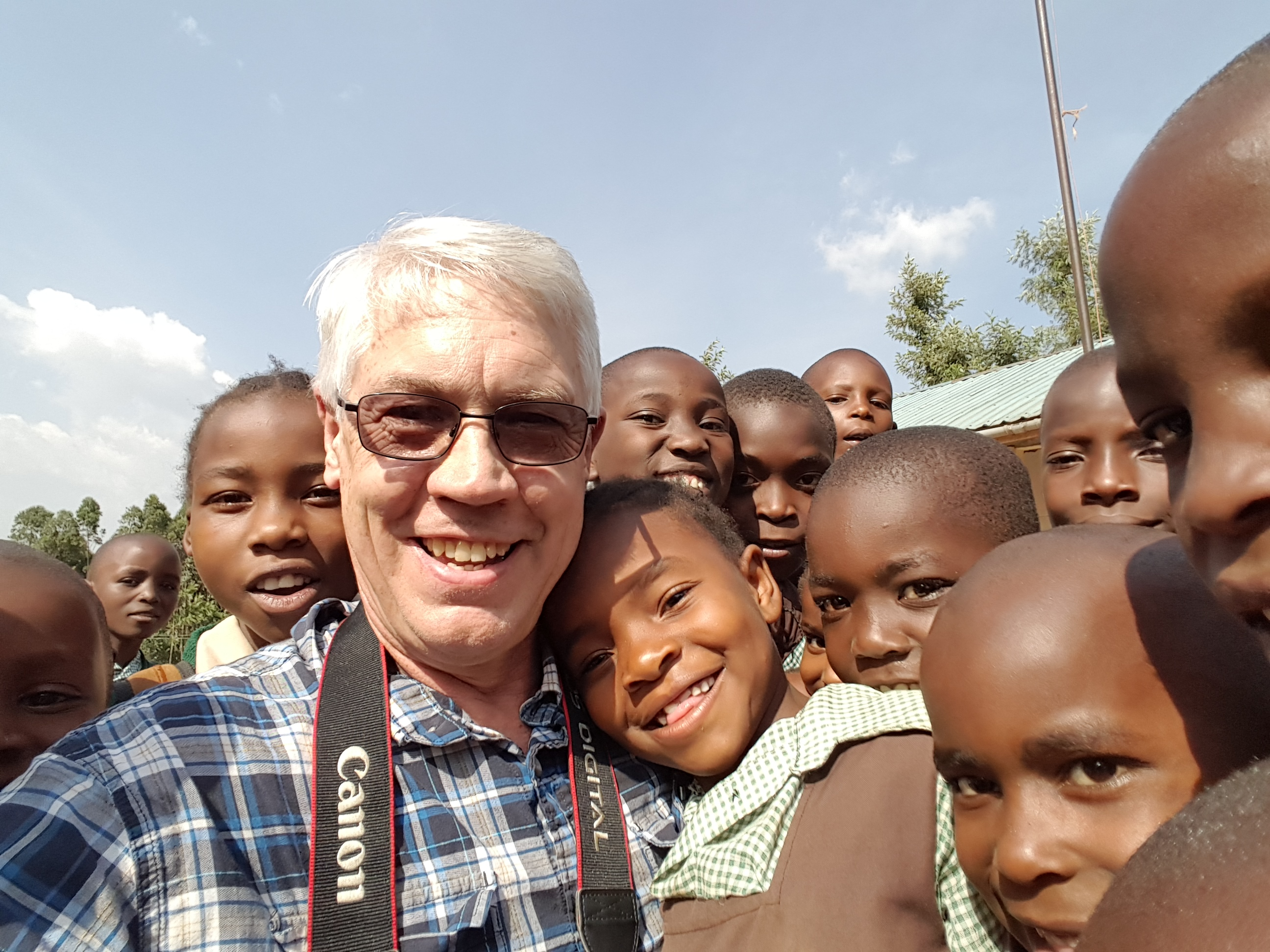 dan haskins with kids in kenya